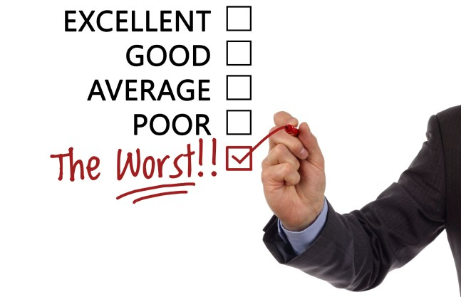 """Tick placed in a new hand written """"the worst"""" checkbox on customer service satisfaction survey form"""