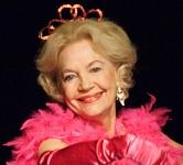 Elizabeth MacRae as Lou Ann Poovie.
