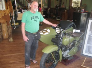 Rusty Graves, proud curator of Barney's motorcycle and sidecar