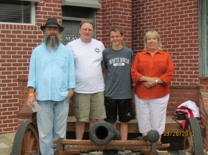 "BIG SHOT--Four members of ""Only One Word I Can Think of...Big"" ""cannon-ize"" their visit at Mayberry Days."