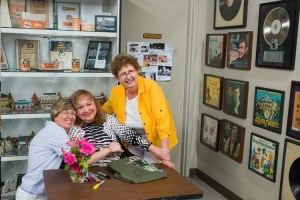 Betty Lynn posing with fans at the Andy Griffith Museum.  Photo by Hobart Jones.