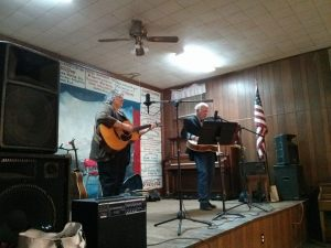 LeRoy Mack (right) on stage with Doug Dillard Band alum Ginger Boatwright at a fundraiser at Zion Community Center in Gordo, Ala., in January.  Photo by Allan Newsome.