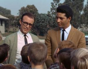 Richard Bull (left) as Mr. Jackson, introducing Flip Conroy (Rockne Tarkington) to Opie and his pals in