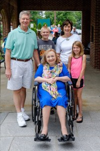 """THE QUEEN AND HER COURT--Betty is surrounded by friends Neil and Pat Coleman of """"Remembering Mayberry"""" chapter (Chillicothe, Ohio) and grandchildren Evan and Alli outside the Andy Griffith Museum in July. Photo by Hobart Jones."""