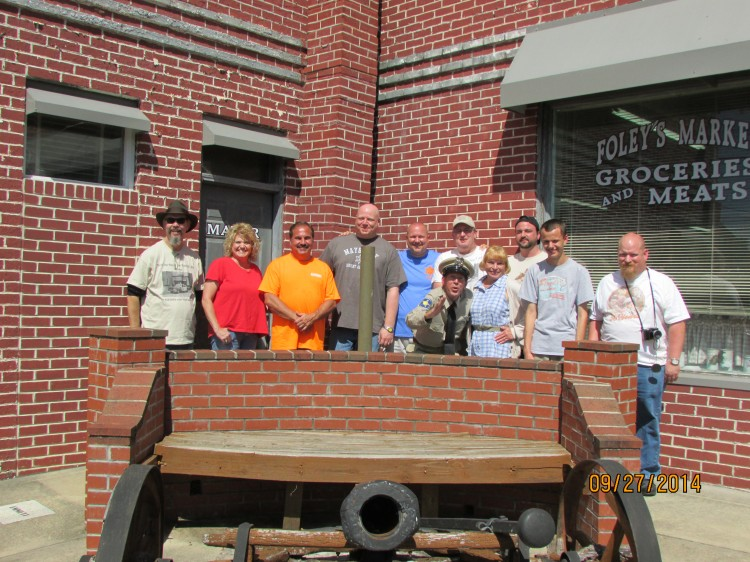 """GUARDING THE CANNON--Members of """"Only One Word I Think Of...Big!"""" chapter (Mint Hill, N.C.) gathered at Mayberry Days for their annual group photo.  Word is that co-founder Tommy Rainwater (far left) scratched his initials (TR) in the side of the cannon.  Photo courtesy of Myron Clark."""