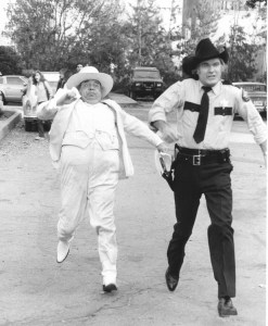 Boss Hogg (Sorrell Booke) and Rosco chase those Duke boys.