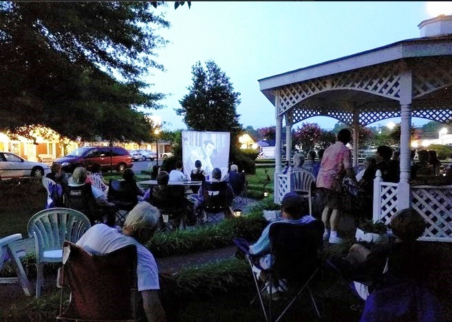 GAZEBO GAZERS--Participants in July's Mayberry Meet-Up enjoy watching a TAGS episode while mingling around the gazebo at the Mayberry Motor Inn.  Photo by Jan Newsome.