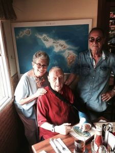 CENTRAL CASTING--Jackie Joseph and husband David Lawrence visit with Dick Linke at his favorite Hawaii hangout. Dick's cast is from a recent tumble at his home. Photo by Bettina Linke.