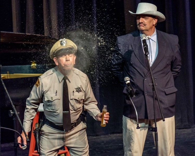 FOOL, PROOF?--The Mayberry Deputy (David Browning) samples the elixir offered by Col. Harvey (Keith Brown). Photo by Hobart Jones.