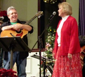 "JOLLY TIME--Rodney Dillard and Maggie Peterson onstage with their ""Mayberry Christmas"" show in Mt. Juliet, Tenn. in December."