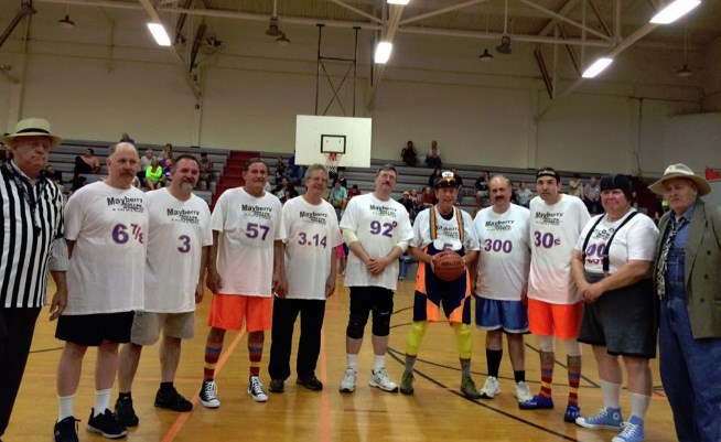 GOOBTROTTERS--As part of Mayberry in the Midwest, assorted characters assembled the Mayberry Bullets basketball team to compete in a game against local players. The team gave it their best shot, but we think this photo is indication enough about their style of play. Photo by Stephanie Gossett.