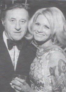 IT'S A TOUGH JOB, BUT--When you're in show business, sometimes duty requires that you have your picture taken with a glamorous Hollywood star--as Dick did here with Angie Dickinson at a Conference of Personal Managers awards banquet in the early 1970s.