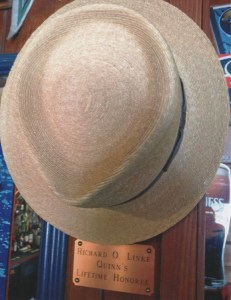 """A PLACE TO HANG HIS HAT--Dick had a designated spot for his hat (marked by a brass plaque, no less!) at his favorite retirement hangout, Quinns Almost by the Sea in Kailua-Kona. Like Norm on """"Cheers,"""" he also had special seat that regulars always knew to keep available for Dick."""