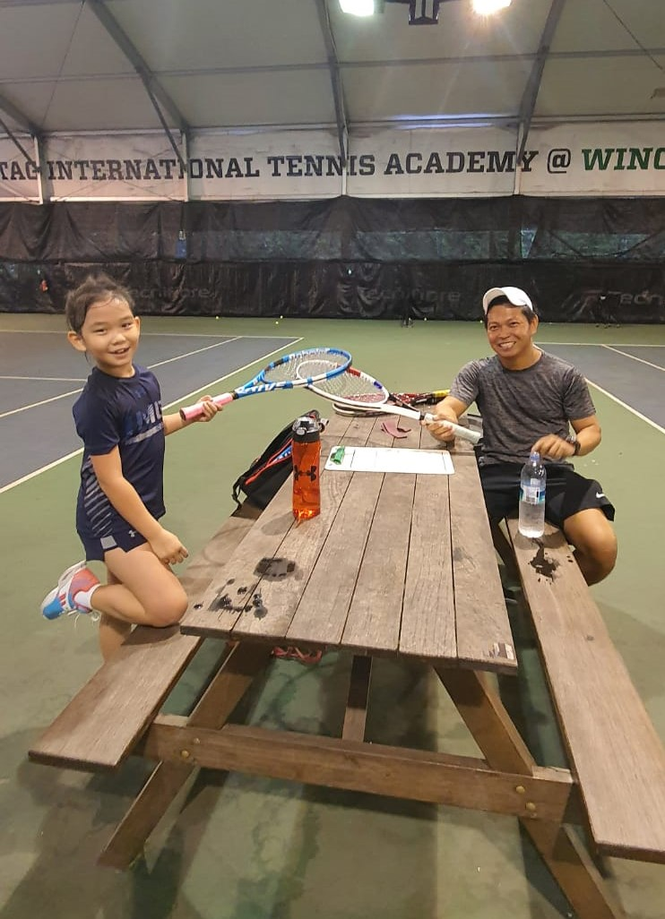Junior Tennis Player Aimee with Coach Rocky