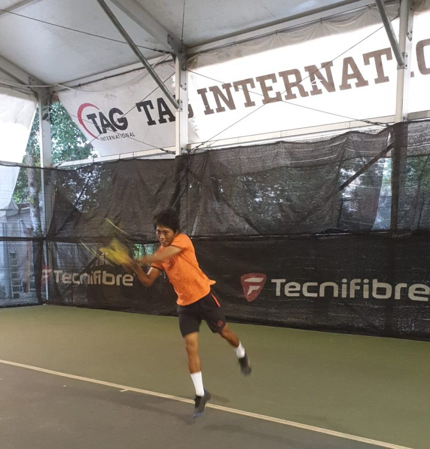 Coach Israel of TAG International Tennis Academy demonstrates how to hit a powerful and accurate tennis double-backhand shot