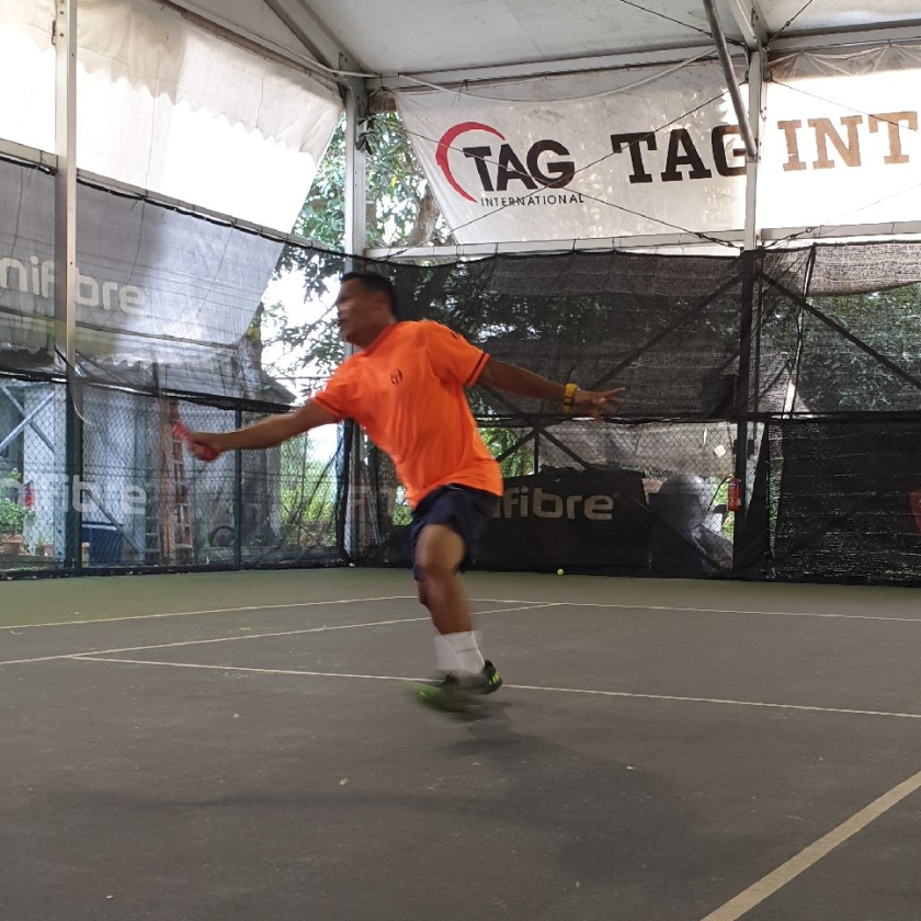 TAG Coach Ray Evan hits a first volley while he is perfectly balanced and out towards his target