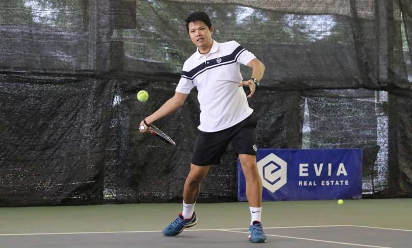 TAG Coach Jeremy Maniago creates space for an inside out forehand