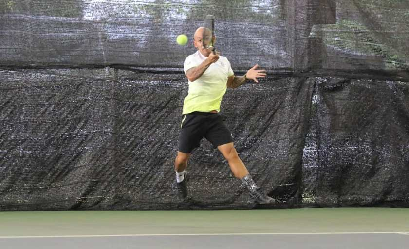 Coach Neils Khoe is always in the air on impact with the ball on his forehand because of the massive release of power into the shot