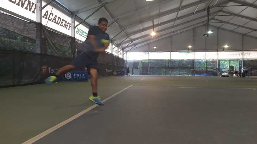TAG Coach Rapeepat Thonghatta hits a high backhand