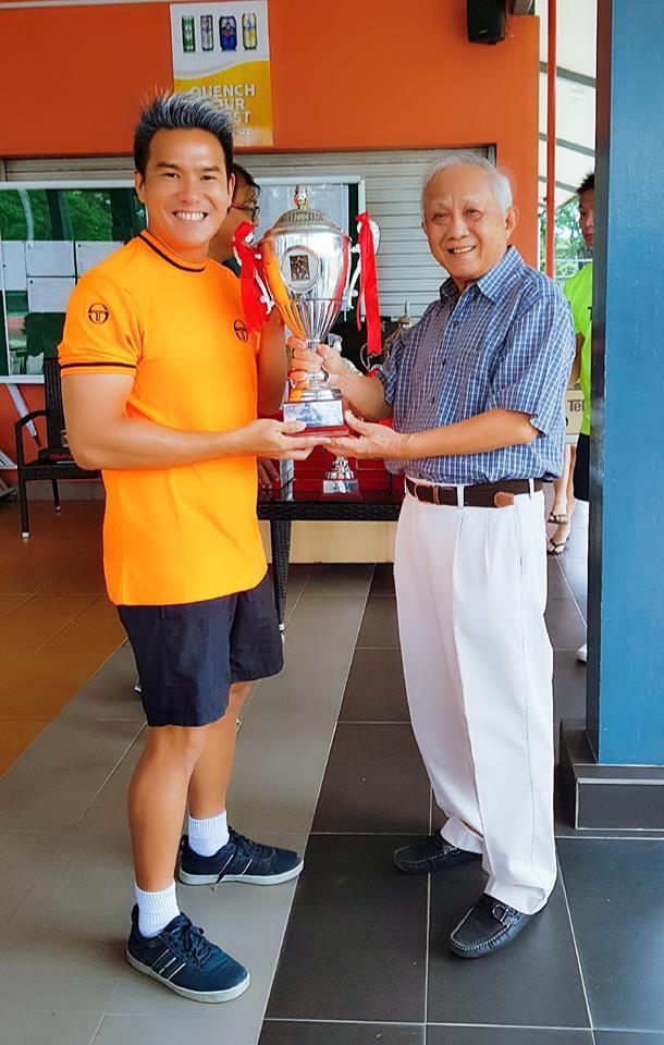 Coach XT with the Singapore Tennis Association Challenge Trophy