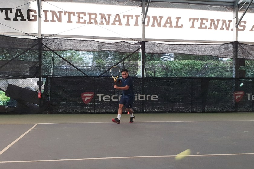 TAG Coach Dave Regencia sets up early for a backhand slice