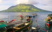 Fishing boats arrive at the market in Bahoi. Tagulandang Island, Sitaro, Sulawesi Utara, Indonesia.