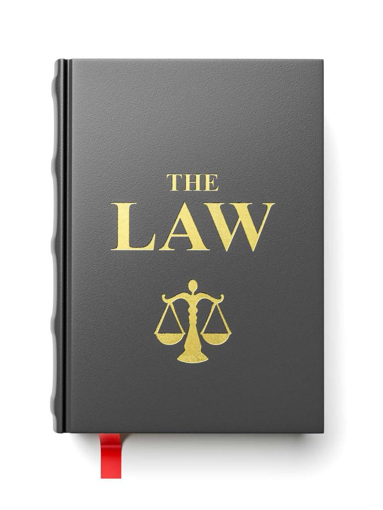 Book of The Law with scales of justice