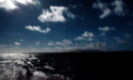 Full moon over Rarotonga as we sailed away
