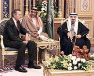 CAPTION:--the attached photo was taken during President Bush's January 2000 trip to Saudi Arabia. It is of President Bush with King Fahd and Prince Bandar (center). Former First Lady Barbara Bush is seen at left. This picture was made at the Royal court.