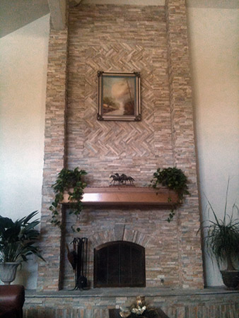 26 Foot High Stone Fireplace With Columns And Arched