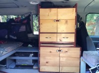 This cabinet maximized our storage behind the driver's seat.