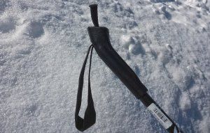 This basic cross-country ski pole handle is made of leather and features a very basic nylon webbing strap. The excess webbing poking out the top could be adjusted to accommodate a larger wrist. © Jared Manninen