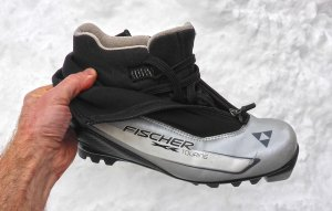 Fischer Touring Classic Cross-Country Ski Boot. There is no ankle support, per se, with this touring boot, but the insulation materials do extend much higher than the carbon lite racing-oriented boot. There's also a metal loop at the base of the zipper designed to hold a larger gaiter in place. © Jared Manninen