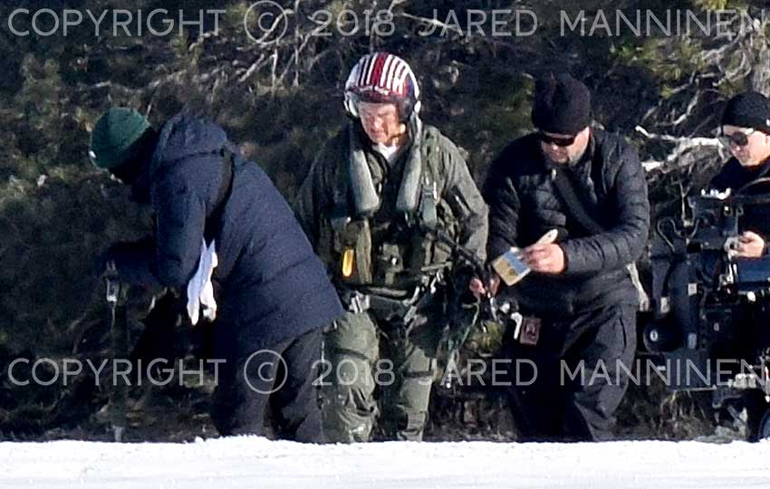 Tom Cruise being attended to by a member of the Top Gun: Maverick production team