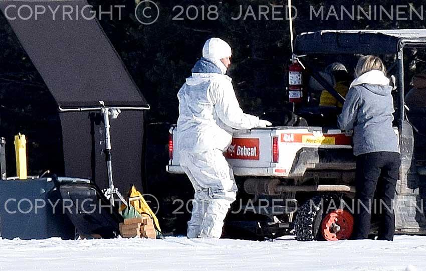 Production team member dressed in white on the set of Top Gun: Maverick