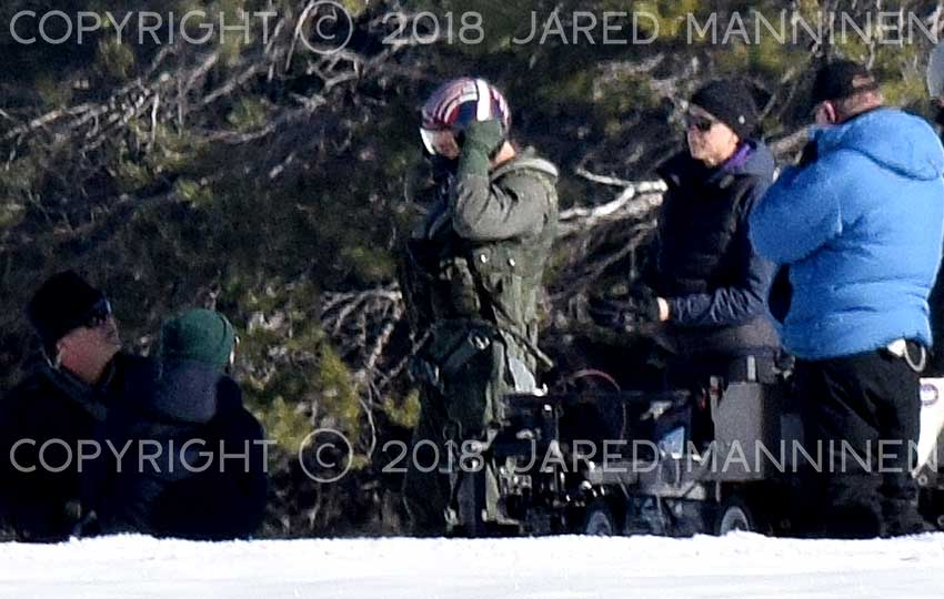 Tom Cruise, as Maverick, puts on his flight helmet to prepare for his scene of recovering from having ejected from his jet. © Jared Manninen