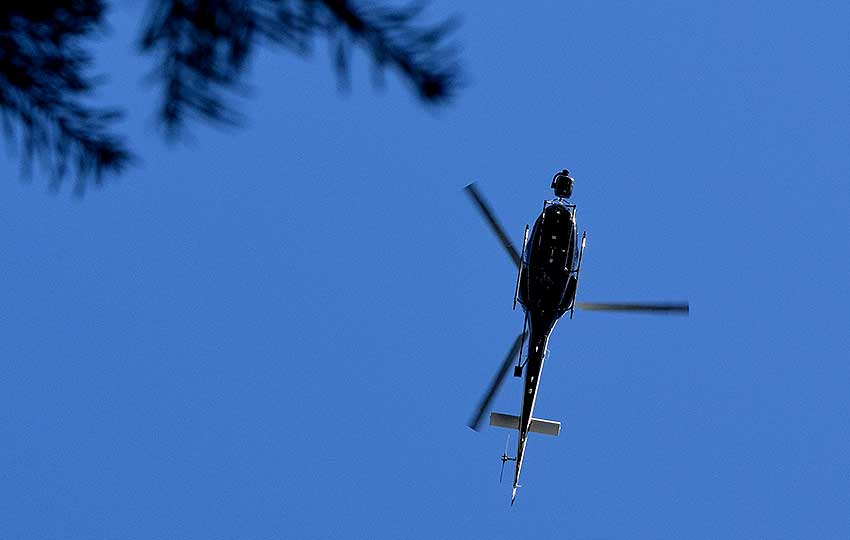 The production helicopter from Top Gun: Maverick flying overhead. I had to take cover in the trees to avoid being spotted. © Jared Manninen
