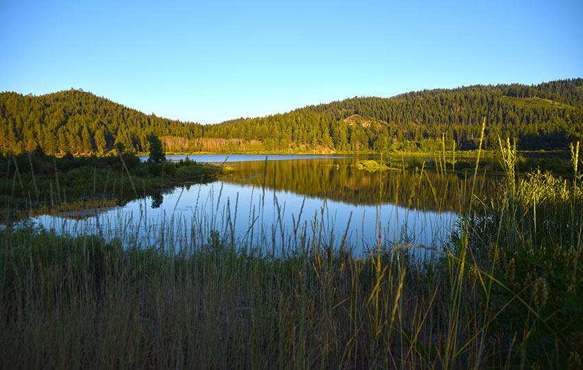 The sun setting on Spooner Lake during summer