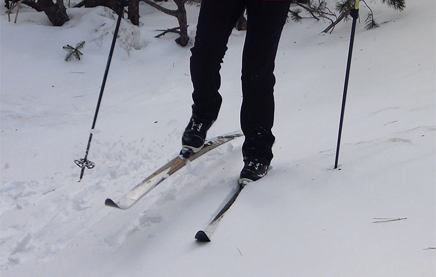 Cross-country skier side-stepping uphill