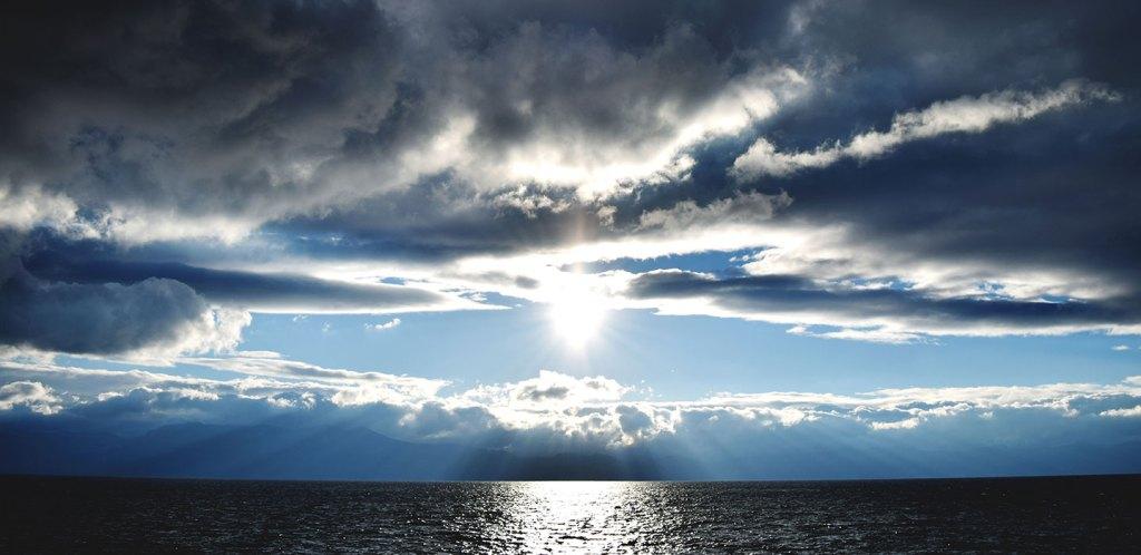 Sun breaking through cloudy skies viewed from Logan Shoals Vista