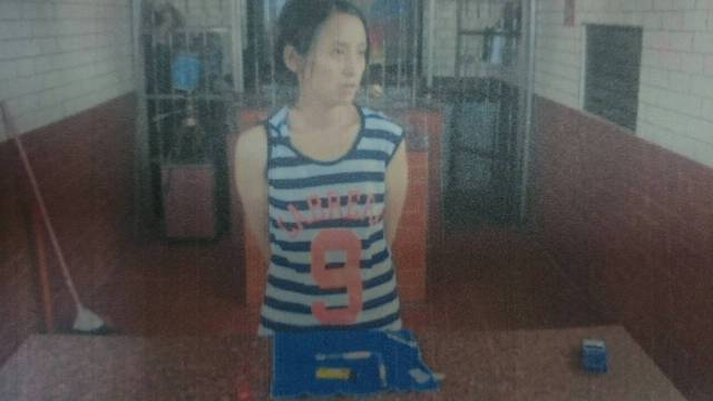 Picture of a woman arrested after an amphetamine-fueled incident at a Taiwanese temple