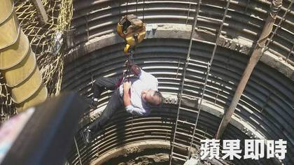 A man is lifted to the surface in a car accident rescue in Hsinchu County, Taiwan