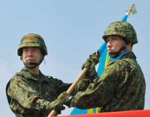 Military commanders are seen with a flag on Yonaguni Island March 28, 2016