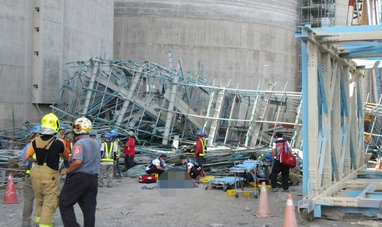 Rescue workers at the scene of an industrial accident