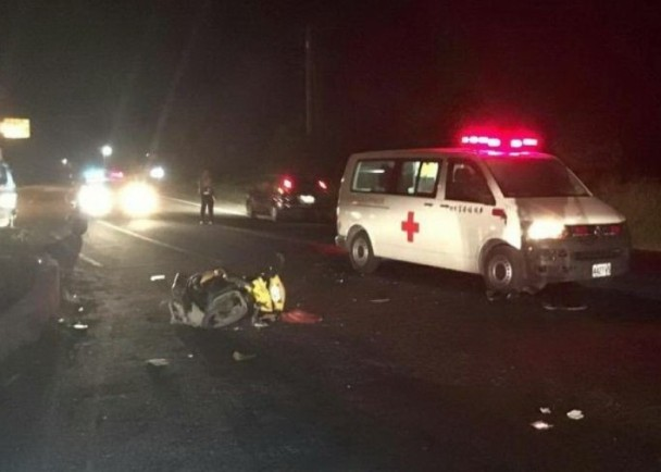 A trashed scooter after hitting an ambulance