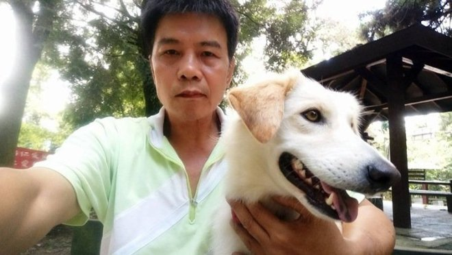 Mr Lin is seen with a dog in a picture from his Facebook account