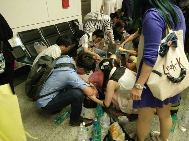 a man receiving first aid at Songshan Train Station