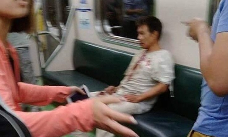 A man suspected as responsible for an explosion on a train is seen shortly after the blast