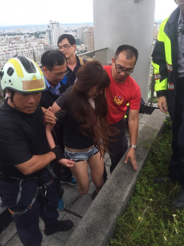 woman and firefighters after rescue
