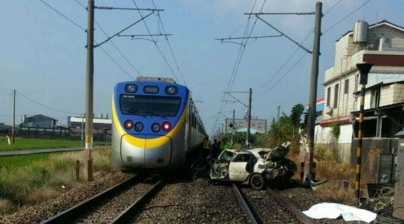 train and wrecked car